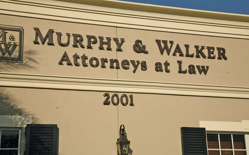 painted matte bronze acrylic letters attorneys office outside