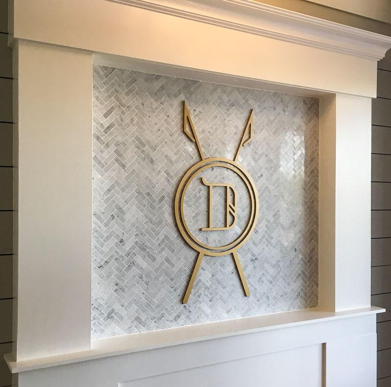 painted gold plastic acrylic logo marble duke