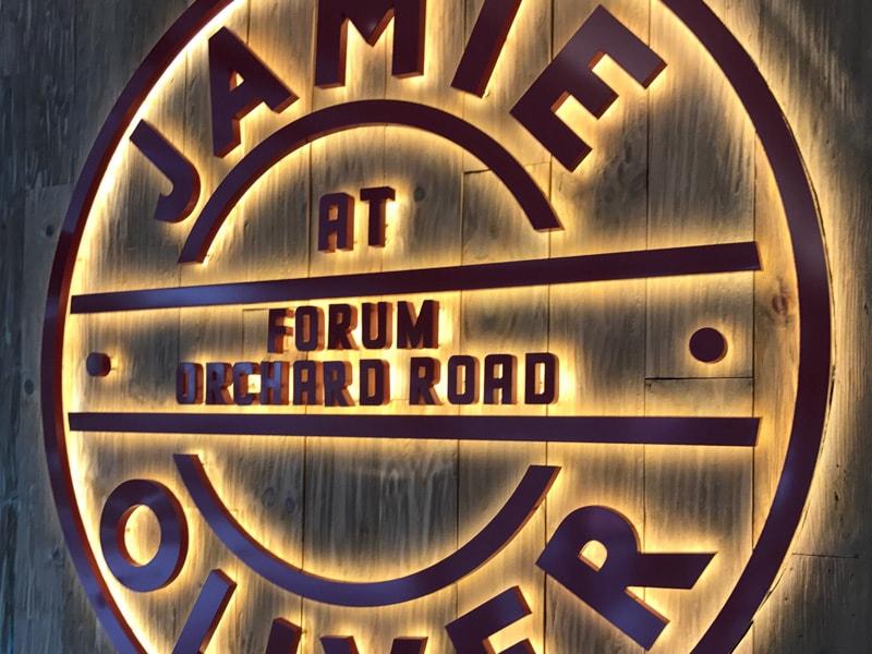backlit brushed copper metal logo with LED halo lit