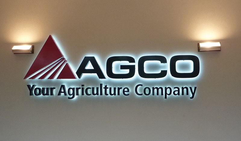 backlit logo red black metal agco office lobby