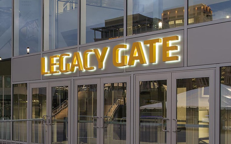 backlit halo lit letters painted yellow stainless steel with white LEDs outside stadium