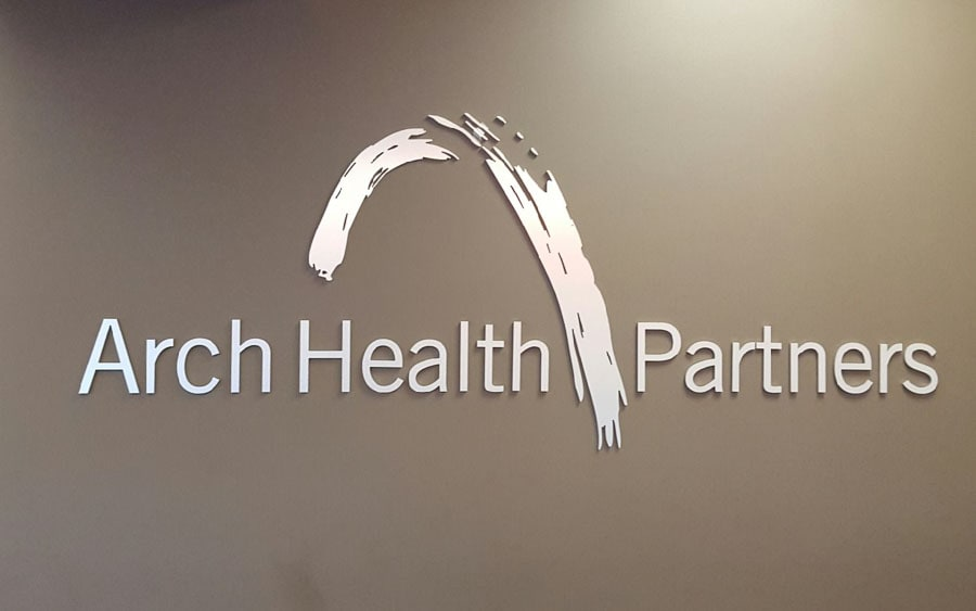 brushed solid cut aluminum letters and logo for arch health lobby wall
