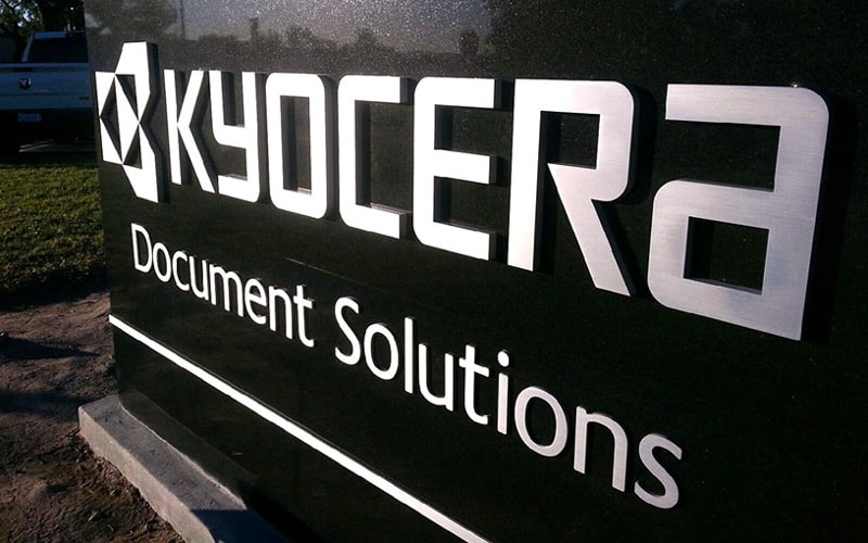brushed solid cut aluminum letters and logo for kyocera entrance monument