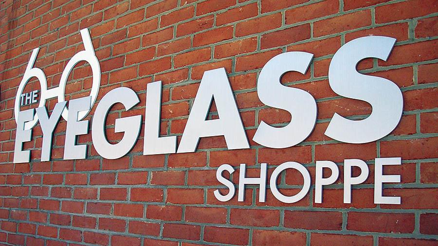 brushed aluminum metal letters glass shop outside