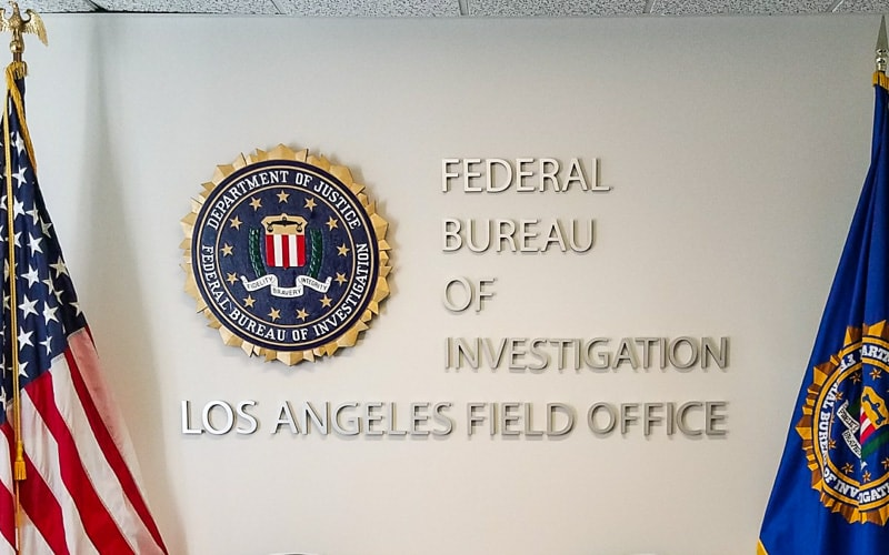 bruhsed aluminum letters and custom routed hdu plaque for FBI inside lobby