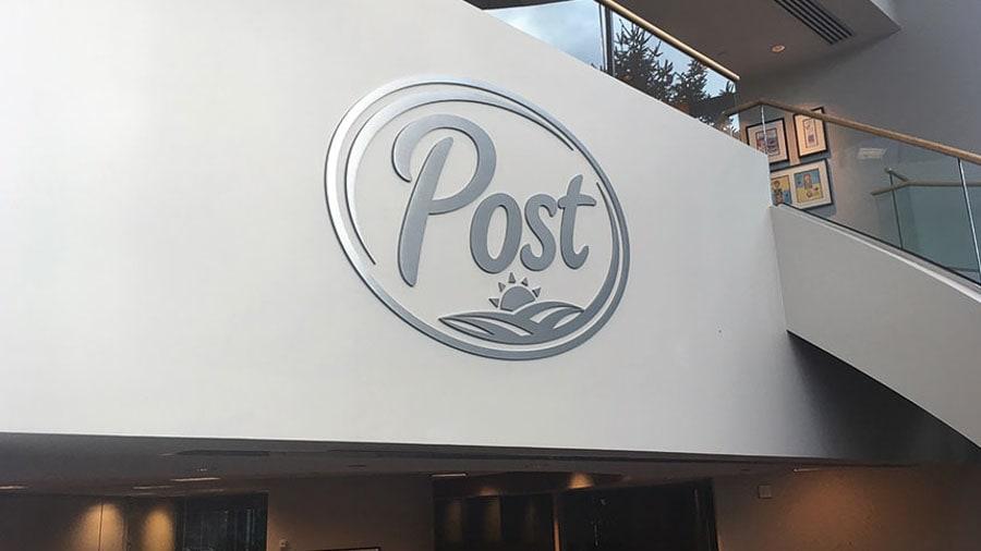 brushed aluminum metal post logo inside office