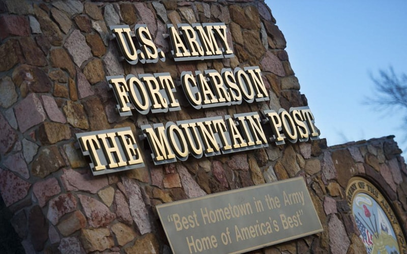 brushed bronze letters mounted on black backer outside fort carson army base