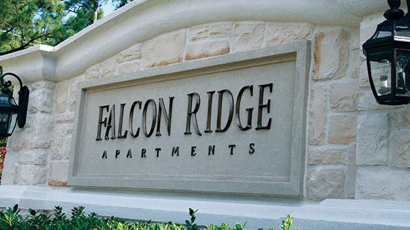 dark oxidized cast bronze metal letters prismatic falcon apartments