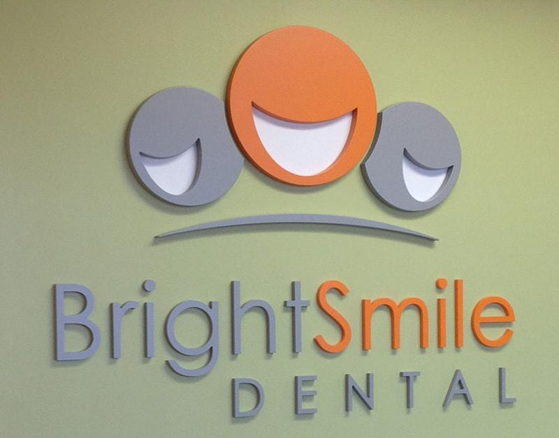 foam logo painted orange bright smile dental