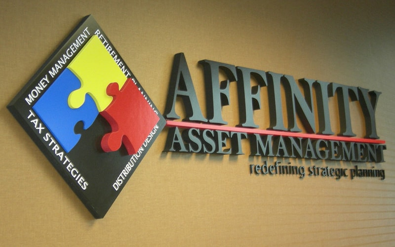 layered painted gatorfoam logo and letters mounted in office lobby