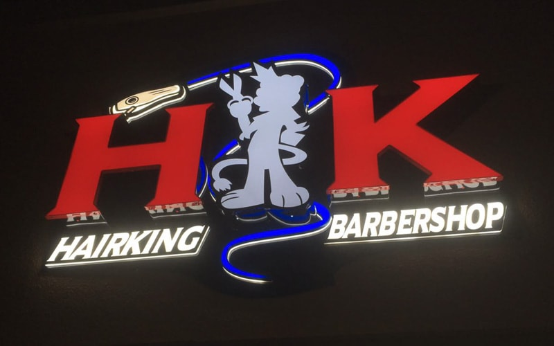 front lit channel letters and logo for barbershop storefront sign