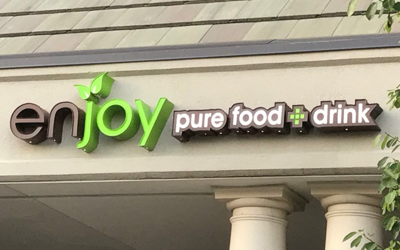 front lit channel letters with vinyl print outside restaurant storefront