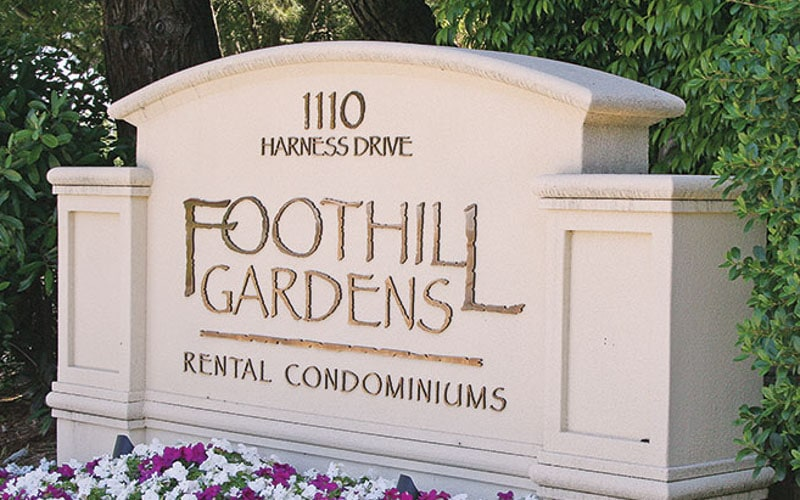 oxidized bronze metal letters outside foothill condo