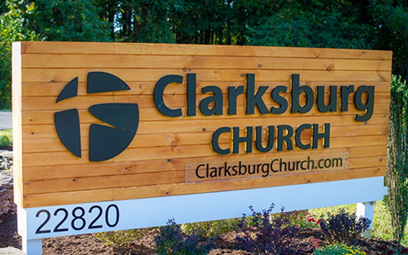 painted black thick aluminum letters moutned on wood planks for church outside