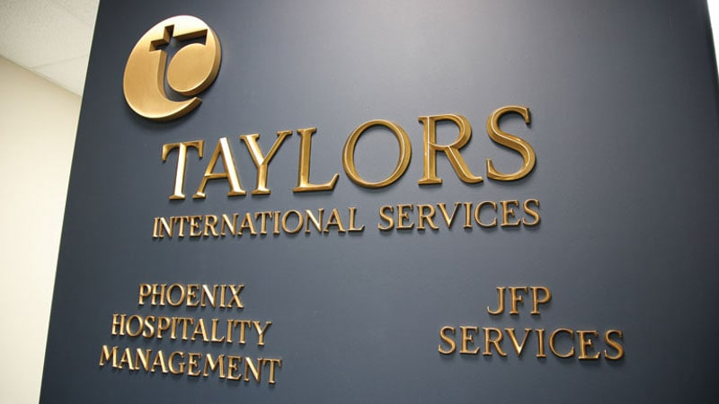 prismatic bronze metal letters logo office lobby taylors 3