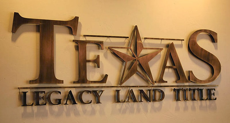 solid cut metal oxidized bronze texas logo office lobby