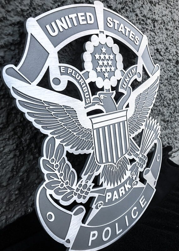 brushed cast aluminum plaque with gray background for us park police badge