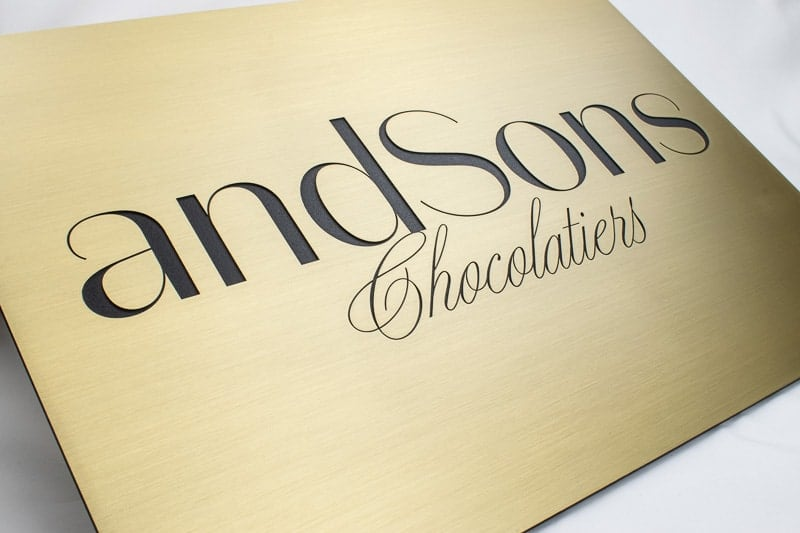 etched brass metal plaque andsons store 2
