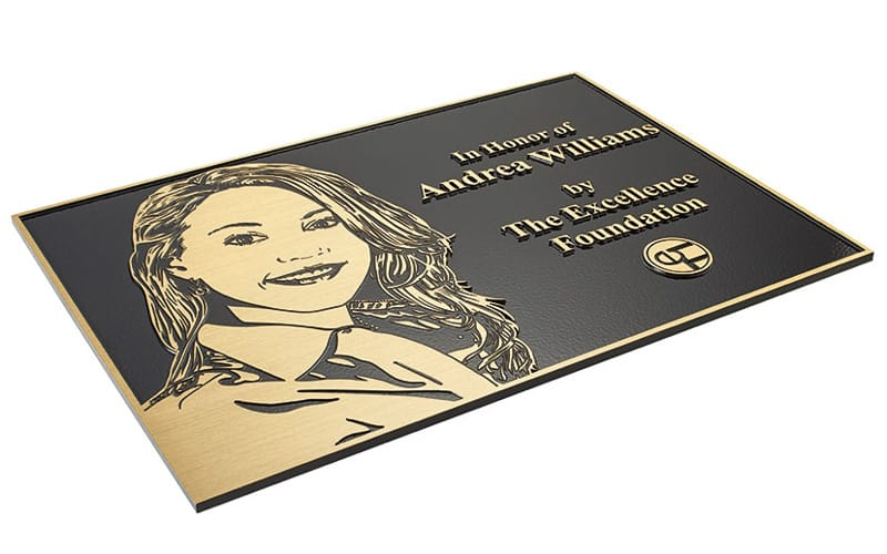 etched brushed brass plaque with flat relief etched portrait for award