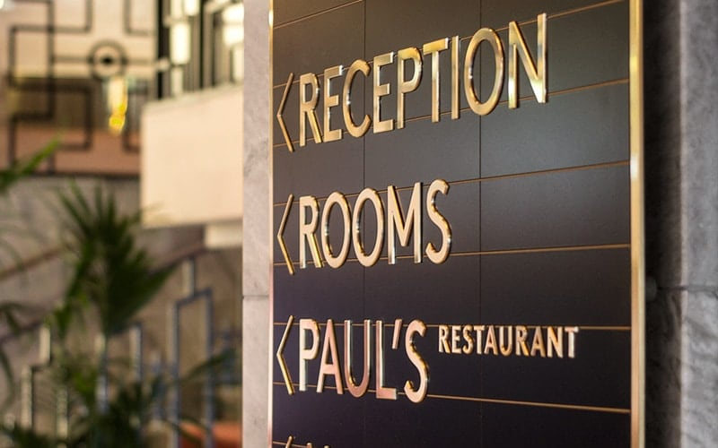polished brass metal plaque directional hotel 3