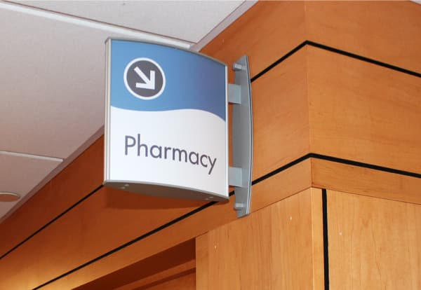 projected curved wall sign with removable face for hopsital medical facility