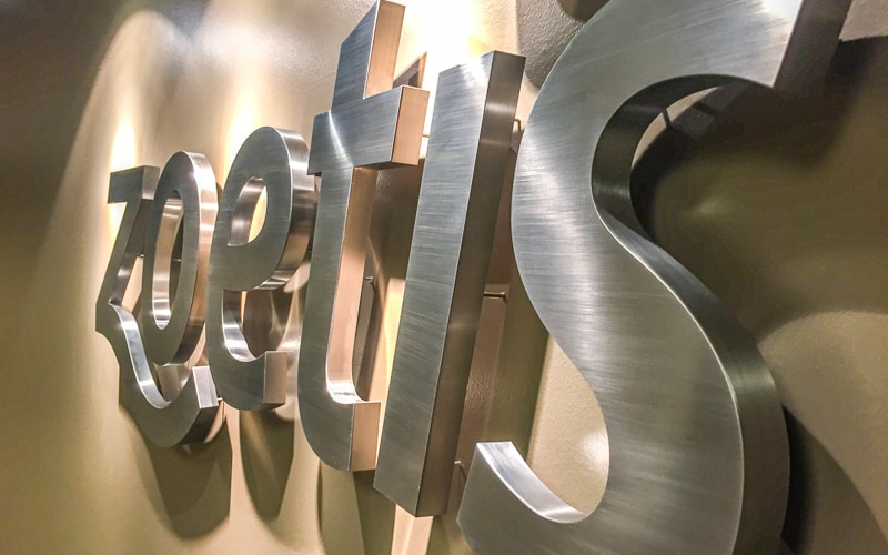 brushed stainless steel thick fabricated letters inside lobby zoetis full