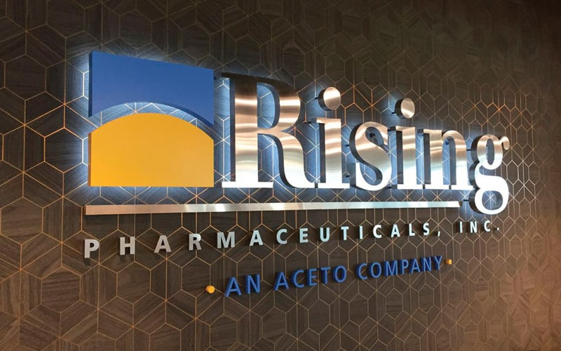 backlit letters logo sign interior lobby in polished stainless steel for rising pharm