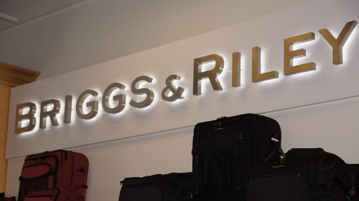 backlit halo letters in brushed stainless steel and white LEDs mounted inside briggs riley store
