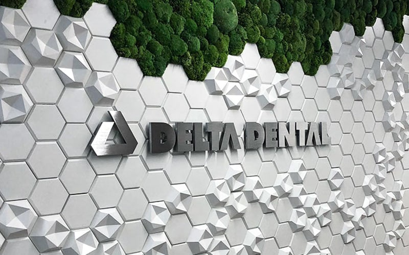 aluminum letters and logo in brushed metal finish for dental office interior lobby sign