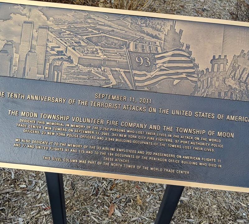 cast bronze plaque with photo portrait for september 11 memorial dedication mounted on post