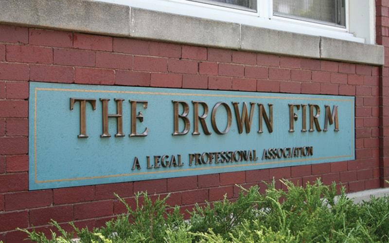 cast bronze letters in oxidized oil rubbed finished outside legal law office