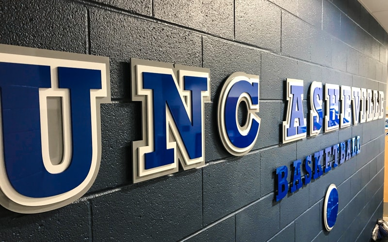 painted layered acrylic plastic letters for inside university basketball lockeroom