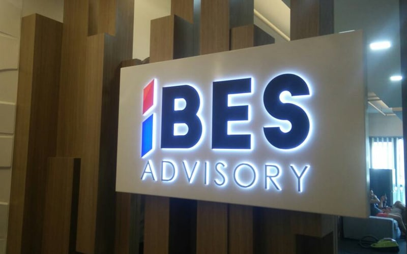 push through acrylic lighted sign in white with custom vinyl face and white leds for bes advisory company office spacy reception area