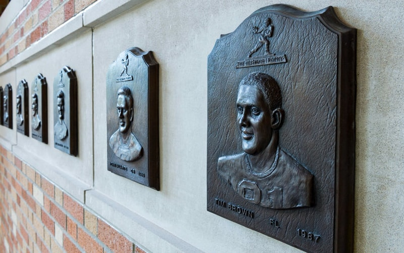 cast bronze plaque in oxidized finish with bas relief scuplted 3d portrait for notre dame football