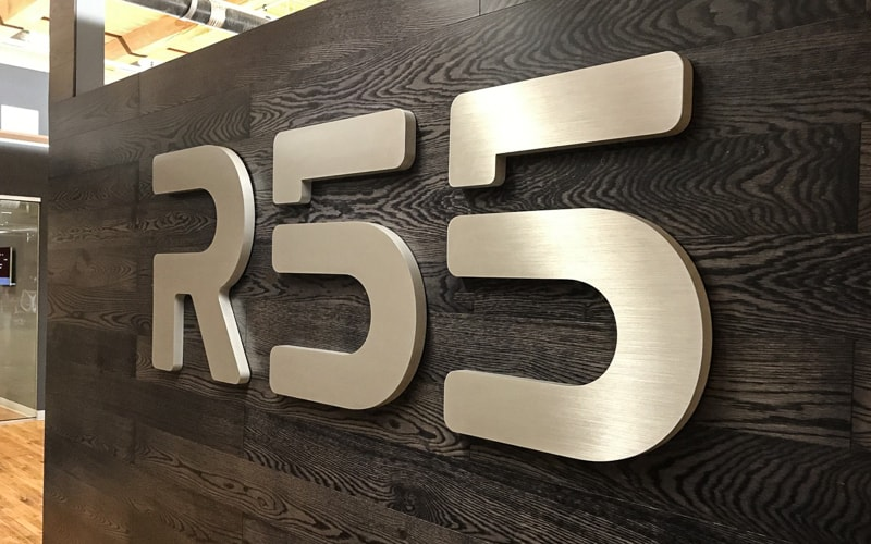 thick brushed fabricated aluminum letters for office lobby wood plank wall