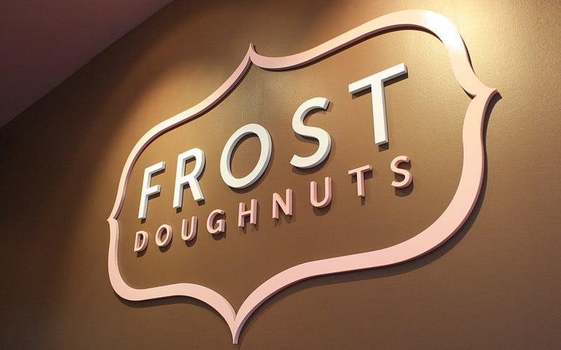 painted gatorfoam logo and letters in white and pink for doughnut shop