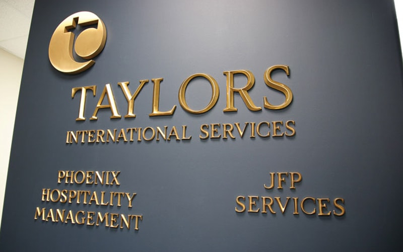 cast bronze letters in polished prismatic beveled face for lobby wall