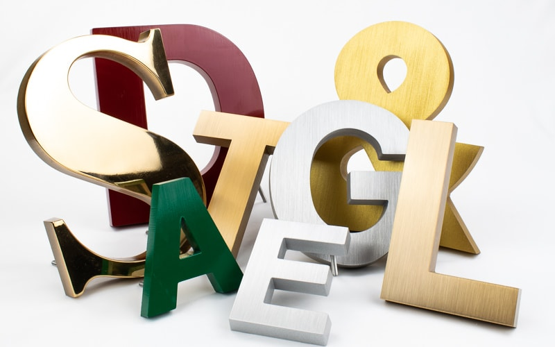 cast metal letter options in bronze and painted brushed aluminum