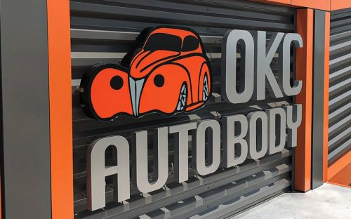 fabricated thick aluminum letters painted metallic silver and full color vinyl print mounted corrugated siding outside