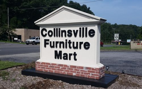 painted black injection molded helvetica minnesota letters outside furniture business