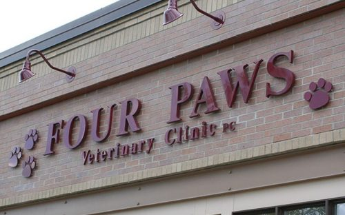 painted maroon injection molded plastic minnesota times bold letters outside veterinary clinic