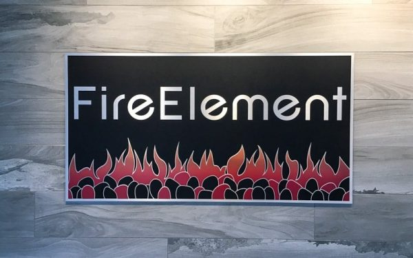 Brushed Cast Aluminum Metal Plaque inside retail store wall with custom paint
