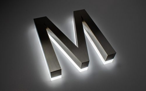 edge lit back lit reverse channel letter in brushed stainless steel