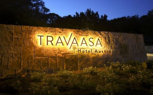 backlit letters and flat cut aluminum letters painted black with warm white leds mounted outside for hotel monument entry
