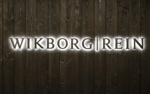 backlit letters with white led halo lighting painted and mounted on wood plank wall of law office reception area