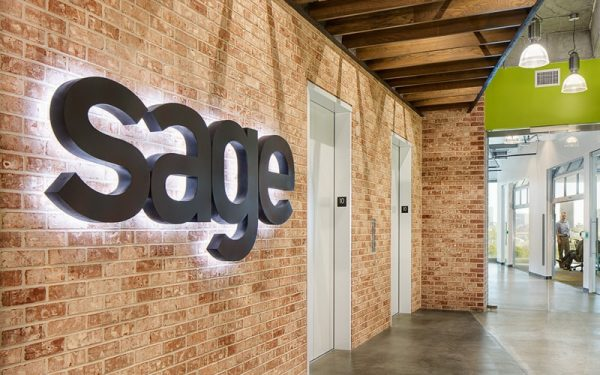 backlit halo letters in painted matte black mounted inside for sage offices lobby sign