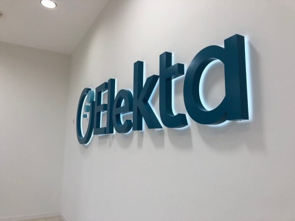 painted blue backlit halo letters and logo inside lobby wall