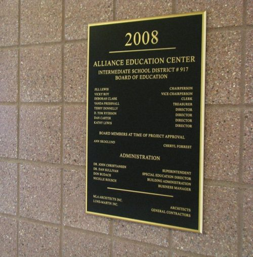 brushed cast brass plaque for inside wall at school district