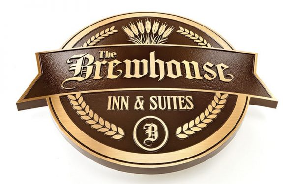 brushed cast bronze plaque with brown background for restaurant
