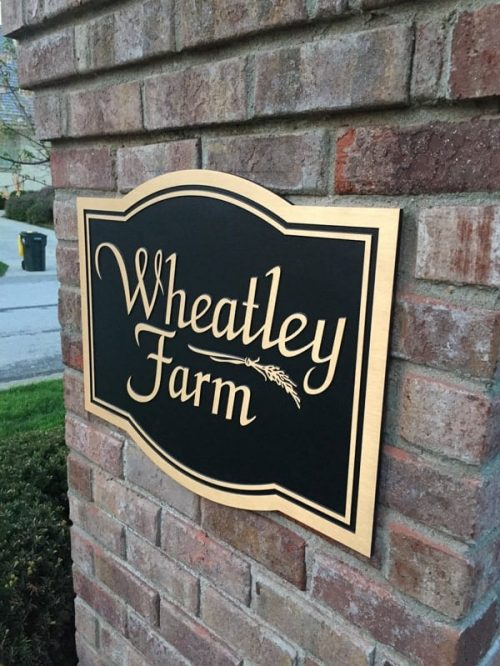 cast brushed bronze plaque with double line border with black background for neighborhood entrance